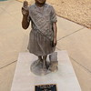 Staff photo by Cathy Spaulding<br /> A bronze statue of a Girl Scout and her cookies stands by Three Rivers Museum. Girl Scout Cookies were said to have originated in Muskogee 100 years ago.