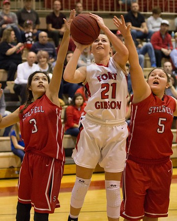 Phoenix special photos by Shane Keeter Above: Fort Gibson's Cailey Cunningham goes in for a layup between Stilwell's Plizia Bishop, left, and Julia Bruner during Thursday's girls semifinal of the Old Fort Classic.