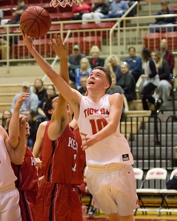 Phoenix special photos by Shane Keeter<br /> Below: Fort Gibson's Jace Shepherd draws the foul from Keys' Stran Eubanks during Thursday's boys semifinal of the Old Fort Classic.