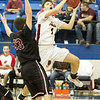 Phoenix special photo by Shane Keeter<br /> Hilldale's Grant Sikes shoots inside the paint against Wagoner's Gage Shoemaker Friday at the Checotah Tournament. Hilldale was knocked off by Wagoner.