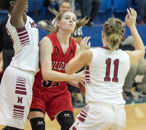 Phoenix special photo by Abigail Washington<br /> Hilldale's Kenzie Mize, center, gets trapped by Muldrow's Taylen Colling, left, and Katie Smith in Saturday's girls championship of the Checotah Crossroads Tournament. The Lady Hornets lost 52-34.