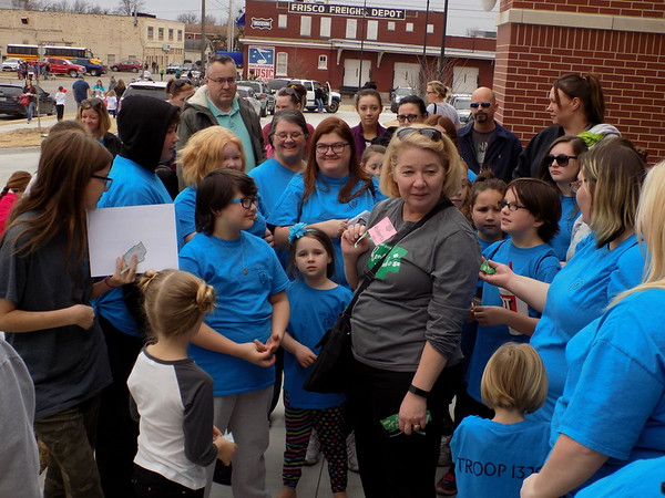 Special photo by Mike Elswick<br /> Tulsan Roberta Preston, chief executive officer of the Girl Scouts of Eastern Oklahoma, visited with dozens of Girl Scouts and parents Saturday while passing out special badges commemorating the 100th anniversary of Girl Scout Cookie sales.