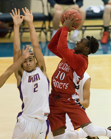 Phoenix special photo by Von Castor<br /> Hilldale's Tre Mitchell drives in and scores the game-tying bucket late in the fourth quarter as Vian's Kaleb Glass defends Friday night in the semfinals of the Checotah Crossroads Classic at the Checotah Event Center. Hilldale rallied for a win and will get Checotah in the finals.