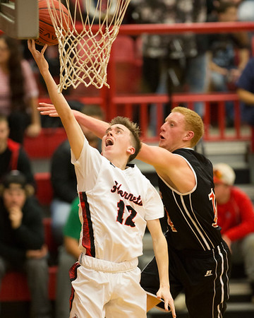 Phoenix special photo by Von Castor<br /> Hilldale's Kaden Bass, left, goes in for a layup past Locust Grove's Aaron Halspain during Tuesday's game at Hilldale Event Center.