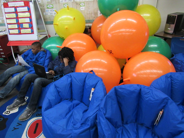 Staff photo by Cathy Spaulding<br /> Jayden Thompson, left, and Isom Smith sit in beanbag chairs in Debra Campbell's classroom at Ben Franklin Science Academy. Campbell got the chairs through an Education Foundation of Muskogee grant.