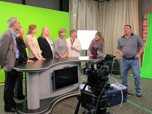 Staff photo by Cathy Spaulding<br /> Muskogee High School teacher Shane Stewart, right, directs the Action in Muskogee Educational Excellence Committee in a video promoting Muskogee Public Schools. Participants are, from left, Mike Garde, Lisa Smith, Laura Wickizer, Belinda Mealer, Connie Stout, Delia Brown and Melony Carey.