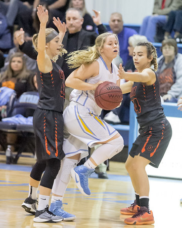 Phoenix special photo by Shane Keeter<br /> Okay's Shayni Green, left, and Kyla Parrell trap Oktaha's Gracie Dickson, center, and force her to pass the ball during Friday's game in Oktaha.