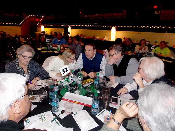 "Special photo by Wendy Burton<br /> Team ""Cuties"" put their heads together during a round at Trivia Challenge 2017, benefiting the Education Foundation of Muskogee."