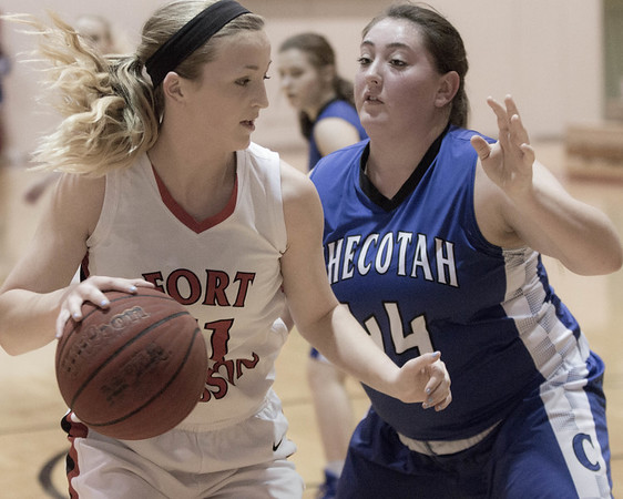 Special photo by Abigail Washington<br /> Fort Gibson's Hannah Johnson works around Checotah's Kyra Collins in action Saturday at Harrison Field House.