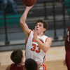 Phoenix special photo by Von Castor<br /> Okay's Austin Skiles shoots over the Spiro defense Monday in the Small School Boys opening round of the 37th annual Bedouin Shrine Classic at Muskogee High School.