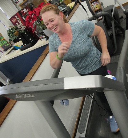 Staff photo by Cathy Spaulding<br /> Michelle LeNoir-Rende uses a treadmill at Strictly Fitness in preparation for the center's Weight Loss Challenge. She said she wants to develop strength and endurance, as well as lose some weight.