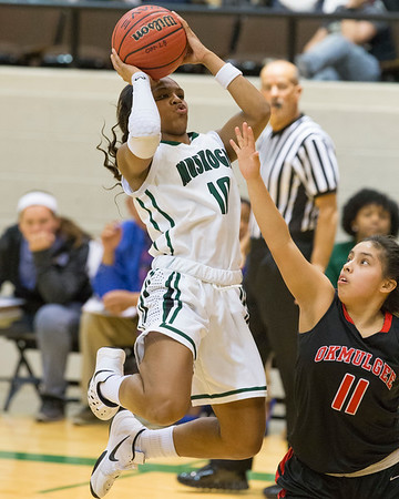 Phoenix special photo by Von Castor<br /> Muskogee's Trena Mims shoots in front of Okmulgee's Sameya King Thursday night in the first round of the Bedouin Shrine Classic large schools bracket at the Muskogee Civic Center.