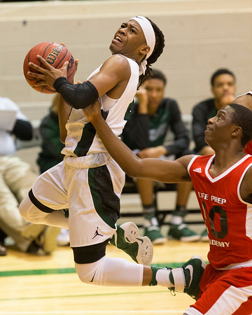 Phoenix special photo by Von Castor<br /> Muskogee's Tyreece Berry shoots in front of Life Prep's Makiah Wade Thursday night in first-round Bedouin Shrine Classic large schools action.
