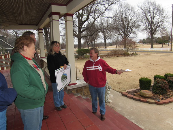 Staff photo by Cathy Spaulding<br /> Homeowner Harvey Price, right, shows his lawn to A More Beautiful Muskogee committee members, from left, Janey Cagle Boydston, Sam Fowler and Francie Martin.