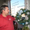 Staff photo by Cathy Spaulding<br /> Sam Kirk displays a wreath his business donated and helped decorate for the Alice Robertson wreath campaign. He said community service gives him a vision for when his children grow up.