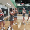 Staff photo by Cathy Spaulding<br /> Okay High School cheerleaders, from left, Hannah Setser, Ashley Davis, Cheyanna Davison, Destiny Drain and Kaia Manskell cheer during a basketball game. Squad members said they are able to get more done in a longer school day, an adjustment Okay Public Schools made when they went to a four-day school week.