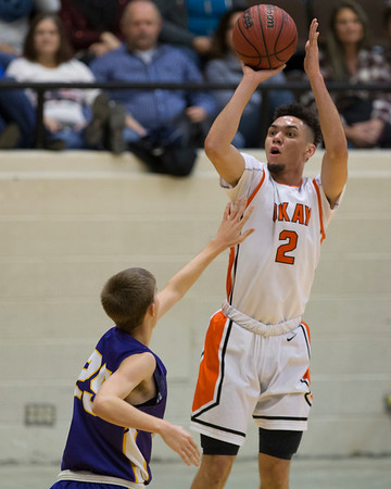 Phoenix special photos by Von Castor<br /> Okay's Caleb Riggs, right, shoots over Red Oak's Jacob Armstrong during the Small School boys championship game Saturday in the 37th Bedouin Shrine Classic. The Mustangs won 49-39.