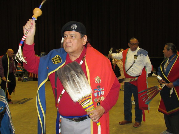 Jimmy Whiteshirt, a Pawnee/Arapaho tribal member from Broken Arrow, shakes a Native American rattle while participating in the powwow.