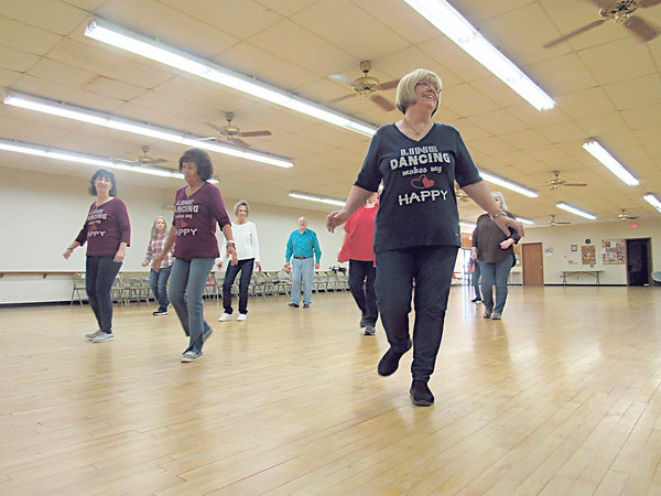CATHY SPAULDING/Muskogee Phoenix<br /> Line dancers, from left, Joyce Cunnius, Jane Watson and Linda Bayless make up the front row of line dancers Monday afternoon at the Hatbox Dance Building.