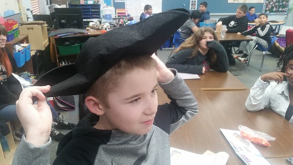 CATHY SPAULDING/Muskogee Phoenix<br /> Creek Elementary fifth-grader Tucker Smith adjusts a felt three-corner hat, which was part of American Revolution lesson kit bought with an Education Foundation of Muskogee grant.