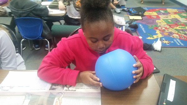 CATHY SPAULDING/Muskogee Phoenix<br /> Creek Elementary fifth-grader Jamiah Maxwell speaks into a Qball while reading a social studies lesson aloud. The Qball amplifies her voice.