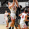 CHRIS CUMMINGS/Special to the Phoenix<br /> Fort Gibson's Tommy French takes a shot in the lane over a McAlester defender during Friday's Large School Boys semifinal of the Bedouin Shrine Classic at the Civic Center. The Tigers beat the Buffaloes 88-67 to advance to today's championship game.
