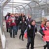 Staff photo by Cathy Spaulding<br /> Temperatures plunged to below freezing on Thursday. Hilldale Elementary students bundle against the cold as they cross the Peak Boulevard pedestrian overpass after school Thursday.