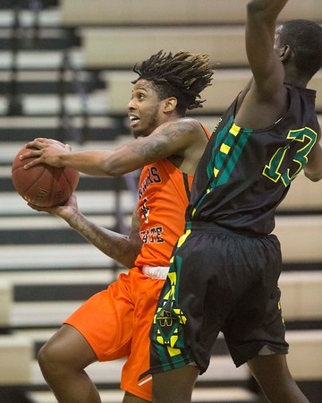 Phoenix special photo by Von Castor<br /> Connors' Ra'Shawn Langston shoots in the lane and is fouled by Western's Webster Simeus Thursday night in Warner.