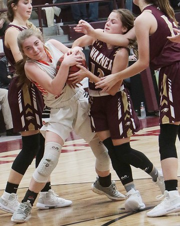 JOHN HASLER/Special to the Phoenix<br /> Warner's Skye Brooksher, right, tussles with Okay's Kinlea Green for a loose ball during Friday's girls semifinal of the Warner Eagle Cherokee Classic. The Lady Eagles beat the Lady Mustangs 48-31.