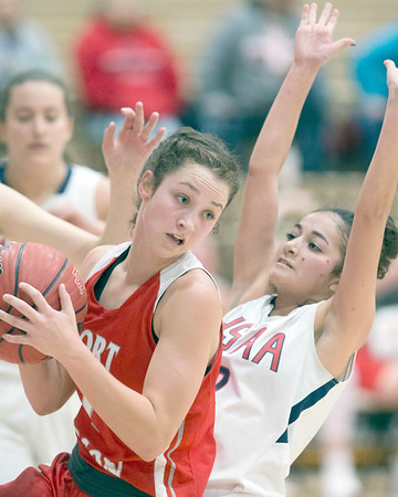VON CASTOR/Special to the Phoenix<br /> Fort Gibson's Zoey Whiteley grabs as offensive rebound in front of HSAA's Anna Thompson Friday night in the Large School Girls semifinal of the Bedouin Shrine Classic at Fort Gibson. The Lady Tigers won 51-27.
