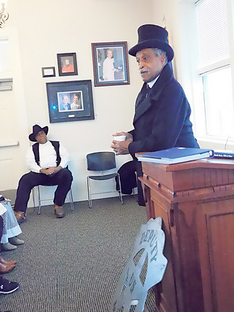 KENTON BROOKS/Muskogee Phoenix<br /> Omar Reed of Fort Gibson portrays Bass Reeves at Saturday's Bass Reeves Memorial at the Three Rivers Museum. Oscar Ray of Muskogee portrays Rufus Cannon, a friend of Reeves and fellow deputy U.S. marshal, listens.