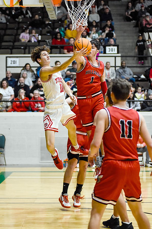 CHRIS CUMMINGS/Special to the Phoenix<br /> Hilldale's Ty O'Neal, right, blocks a score attempt by Fort Gibson's Caden Dennis during the Large School Boys championship game of the Bedouin Shrine Classic on Satiurday at the Civic Center.