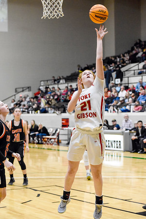 CHRIS CUMMINGS/Special to the Phoenix<br /> Fort Gibson's Reese Webb puts a rebound back to the basket during the Large School Girls championship game of the Bedouin Shrine Classic on Saturday at the Civic Center.
