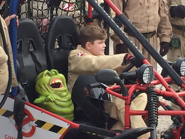 Staff photo by Mike Elswick<br /> Trevor Patterson, 12, checks out his new Ghostbusters-themed go-cart Friday at Oktaha Public Schools as a toy green ghost Slimer character sits next to him. Patterson, who has cystic fibrosis, was presented the go-cart as part of his wish from the Make-A-Wish Oklahoma  organization.