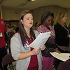 "Staff photo by Cathy Spaulding<br /> Jack C. Montgomery VA Medical Center employees, from second left, Cindy Kroll, Lanise Jamerson and Stacie Williams sing ""Lift Every Voice and Sing"" at the opening of the medical center's Dr. Martin Luther King Jr. program Friday."