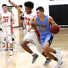 Phoenix special photo by John Hasler<br /> Oktaha's Dean Austin, right, drives past Okay's Lloyd Houston during Friday's game in Okay. The Tigers beat the Mustangs 73-58.