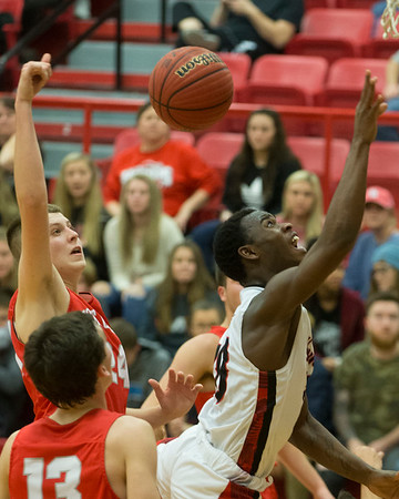 Phoenix special photo by Von Castor<br /> Hilldale's Tre Mitchell gets his shot blocked from behind by Fort Gibson's Conner Calavan Friday night at the Hilldale Event Center.