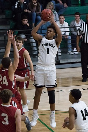 Phoenix special photo by Abigail Washington<br /> Muskogee's CJ Parks puts up a shot over an Owasso defender during Friday's game at Ron Milam Gymnasium. The Roughers lost 61-55.