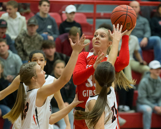 Phoenix special photo by Von Castor<br /> Fort Gibson's Danielle Johnson shoots over Hilldale's Kenns Hoffman, right, and Carson Eichling, left, during Friday's game at the Hilldale Event Center. Johnson had six points and seven rebounds as the Lady Tigers won 76-26.