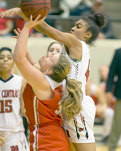 VON CASTOR/Special to the Phoenix Fort Gibson's Kynzi London is fouled in the lane by East Central's Journey Armstead Saturday night in the large school finals of the Bedouin Shrine Classic at the Muskogee Civic Center.