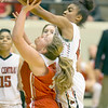 VON CASTOR/Special to the Phoenix<br /> Fort Gibson's Kynzi London is fouled in the lane by East Central's Journey Armstead Saturday night in the large school finals of the Bedouin Shrine Classic at the Muskogee Civic Center.