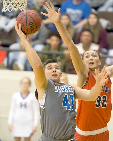 VON CASTOR/Muskogee Phoenix<br /> Haskell's Zane Adams shoots in front of Kansas' Seth Evans on Saturday in the finals of the Small School Boys division of the 39th Bedouin Shrine Classic at the Muskogee Civic Center. Adams had 20 points to lead the Haymakers to a 54-48 win giving Haskell its first title in six tries.