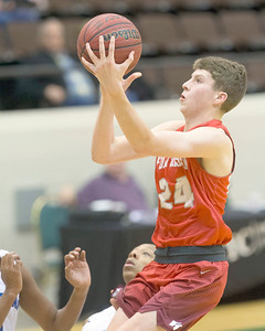 VON CASTOR/Special to the Phoenix Fort Gibson's Conner Calavan scores in the lane over a OKC South East player Saturday night in the Large School Boys final of the Bedouin Shrine Classic.