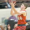 VON CASTOR/Special to the Phoenix<br /> Fort Gibson's Conner Calavan scores in the lane over a OKC South East player Saturday night in the Large School Boys final of the Bedouin Shrine Classic.