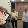 CATHY SPAULDING/Muskogee Phoenix<br /> Muskogee County Sheriff Rob Frazier, right, visits with Fort Gibson officials — from left, Mayor Michael Sharpe, town attorney Larry Moore, trustee Tim Murphy — Monday night after town trustees voted to hire Frazier as Fort Gibson police chief.