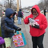 Special photo by Cathy Spaulding<br /> McKaylah Corbin, left, 8, and Savannah Corbin, 9, get candy from a Dream Team member during Monday's Martin Luther King Jr. Day Parade.