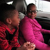 Staff photo by Cathy Spaulding<br /> Khash Pritchett, 6, talks with his mother, Libby Pritchett, while they wait inside her car for Monday's Martin Luther King Jr. Day Parade. Cold weather prompted many to watch the parade from inside their vehicles.