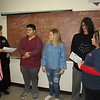 Staff photo by Cathy Spaulding<br /> Veterans of Foreign Wars Post 474 Auxiliary President Sandi Stafford, left, and Post Commander Tonja Ballard, right, present Patriot's Pen certificates to winning students at Fort Gibson Middle School. They are, from second left, James Kemble, Kenzie Sadler and Andrew Mendez.