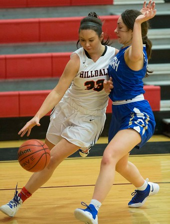VON CASTOR/Phoenix Special Photo<br /> Hilldale's Makayla Williams drives past Oologah's Lilly Ruark Tuesday evening at the Hilldale Event Center.