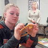 Staff photo by Cathy Spaulding<br /> Hilldale High freshman Halle Triplett, left weaves a dream catcher web during a Native American history and culture class taught by Tera Shows, right.
